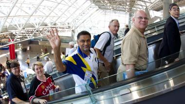 Rotarians on escalator at the Rotary International Convention.